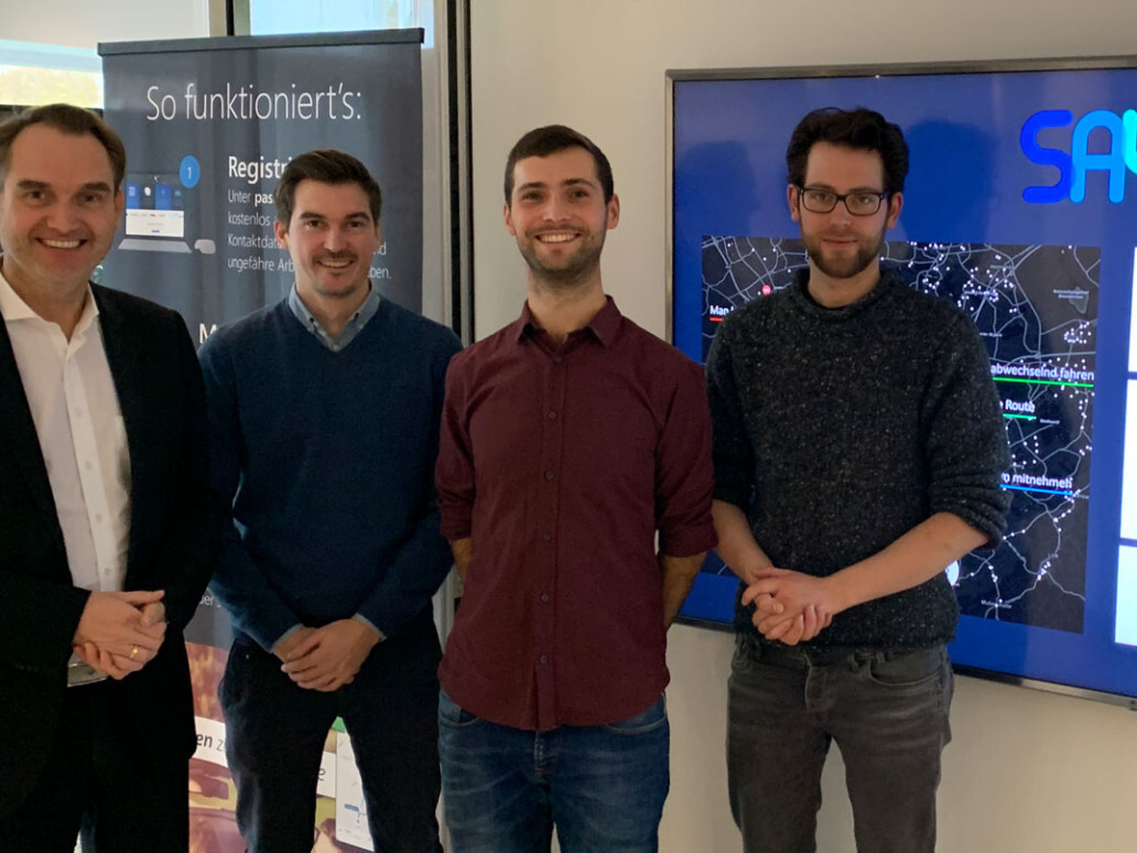 Dr. Oliver Grün, Board Member and CEO of GRÜN Software AG with Benjamin Dörries (COO), Daniel Bogdoll (CEO) and Philipp Uhl (UI / UX Design) from SAYM (from left to right).